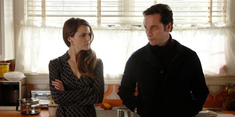 This TV publicity image released by FX shows Keri Russell as Elizabeth Jennings, left, and Matthew Rhys as Philip Jennings in a scene from the spy drama