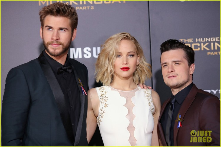 liam-hemsworth-josh-hutcherson-wear-pins-for-france-mockingjay-16