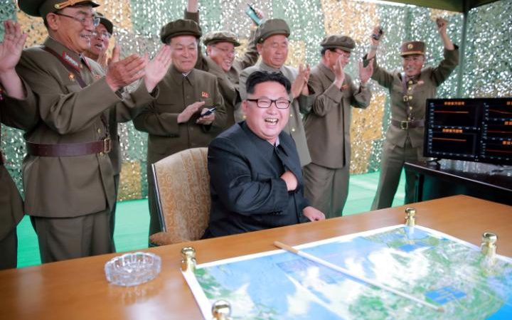101485722_north_korean_leader_kim_jong_un_reacts_during_a_test_launch_of_ground-to-ground_medium-large_transzgekzx3m936n5bqk4va8rtgju7qtstfrd21mzxayo54